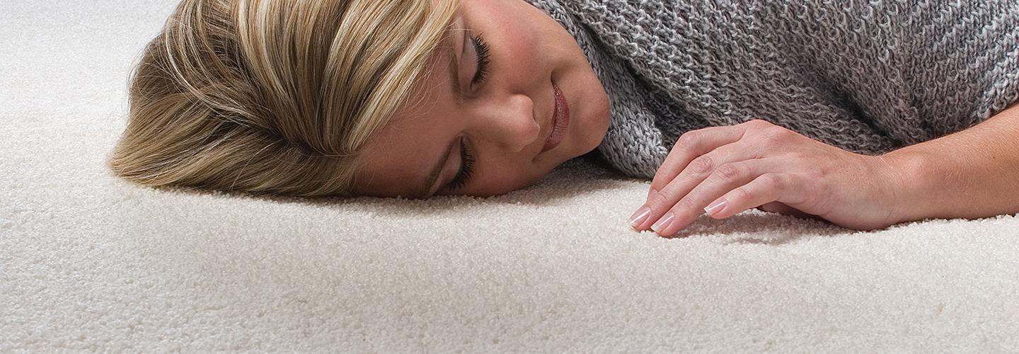 Woman lying on beige Infinity nylon carpet